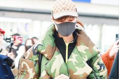 李宇春身穿抗寒能力十级的迷彩羽绒服现身机场 一脸呆萌星范十足