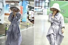 赵丽颖产后现身机场包裹严实 身材恢复捂脸娇羞似少女