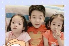 杨阳洋被诊断为猪流感携带者。杨威抱着儿子接受治疗。他的脸是松弛的