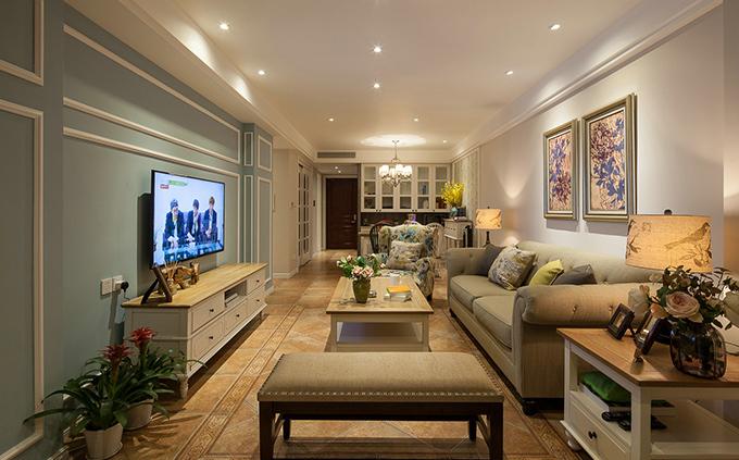 以大面积的石膏线条腻子粉刷的清新蓝作为电视背景墙,给人唯美的感觉