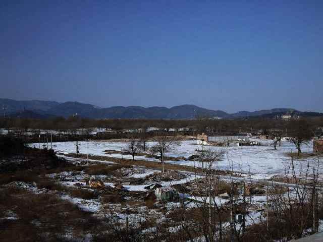 在颐和园东南方向不远的地方,有个叫六郎庄的村子,因盛产清水稻而