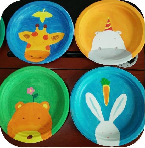30 活动内容:亲子手工课堂——纸盘画 用生日蛋糕小纸盘制作出一个个图片