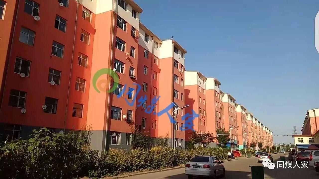 恒安新区西益花苑小区,楼房的颜色是淡红色.