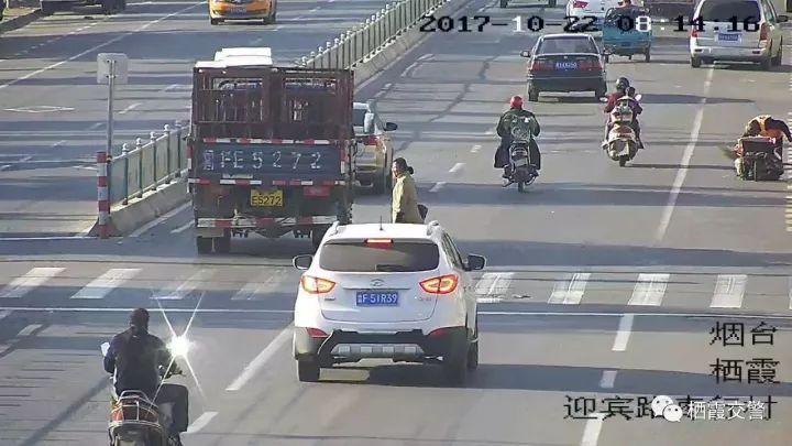 大庆机动车�y��9i!9�!_违法地点:栖霞大庆路学校处 违法原因:机动车不礼让行 违法车辆:鲁fev