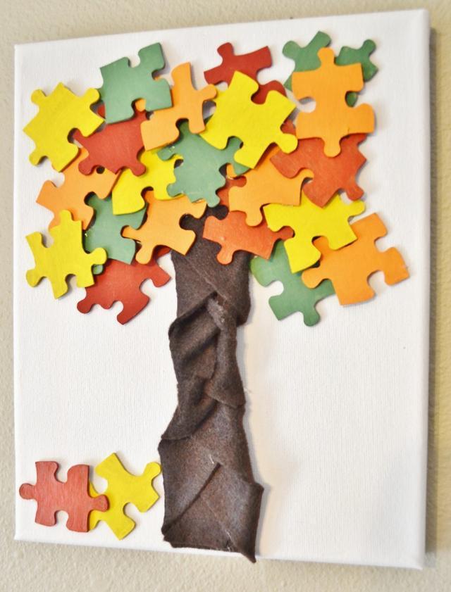 文化 正文  如果一棵树的枝桠上长的不是树叶,而是一小块一小块的拼图图片