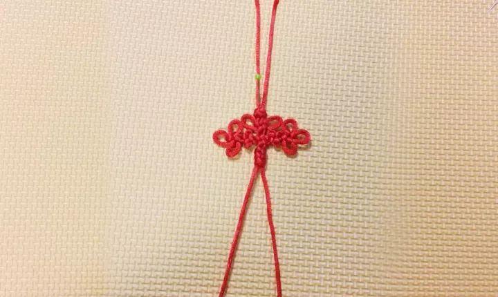 娱乐 正文  酢浆草结是一种简单的中国结编法 用珠针定型