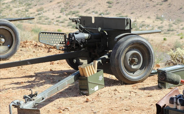 托���)�-_军事 正文  型号不明,似乎是一门57炮 口径型号不明 然后用f150拖走