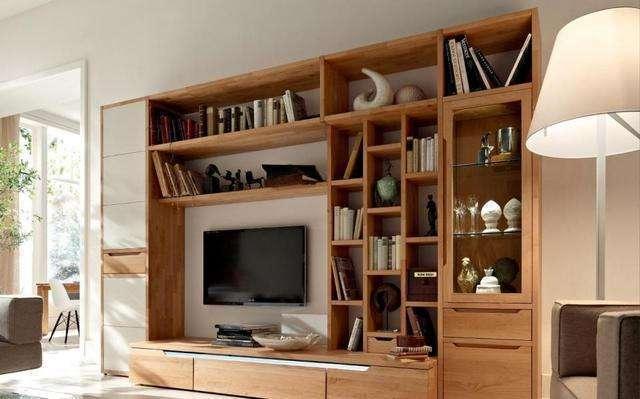 时尚 正文  电视背景墙周围不要做太多柜子,虽然好像多了很多储物空间