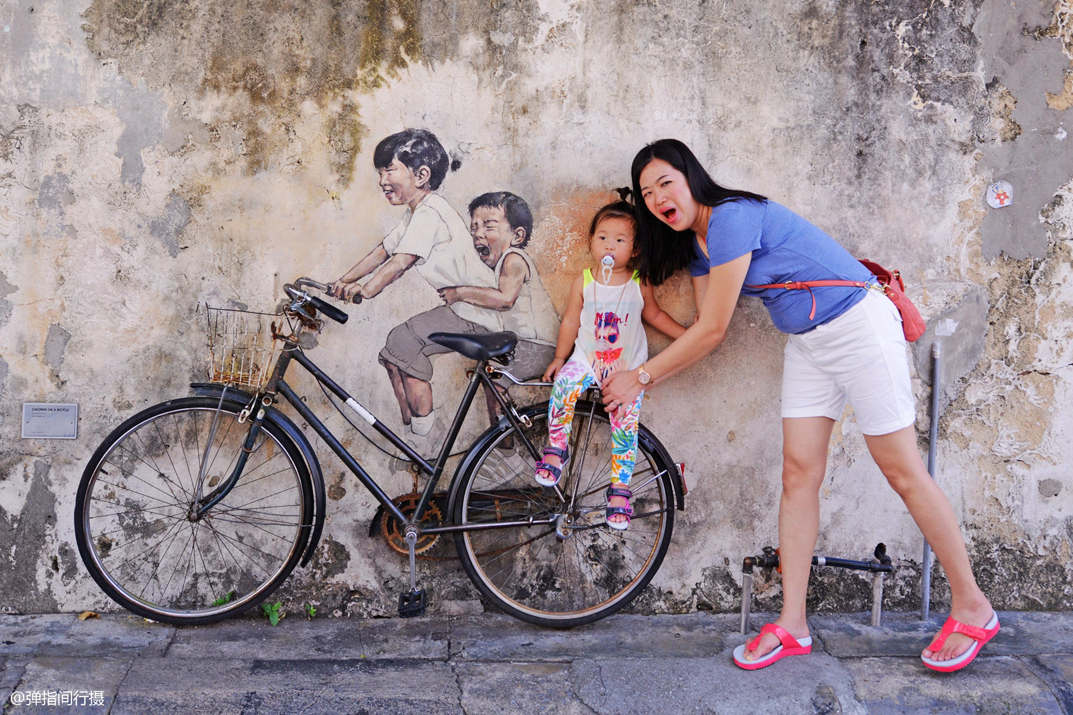 靠街头涂鸦出名的马来西亚槟城,后被很多中国古镇效仿,你咋看?
