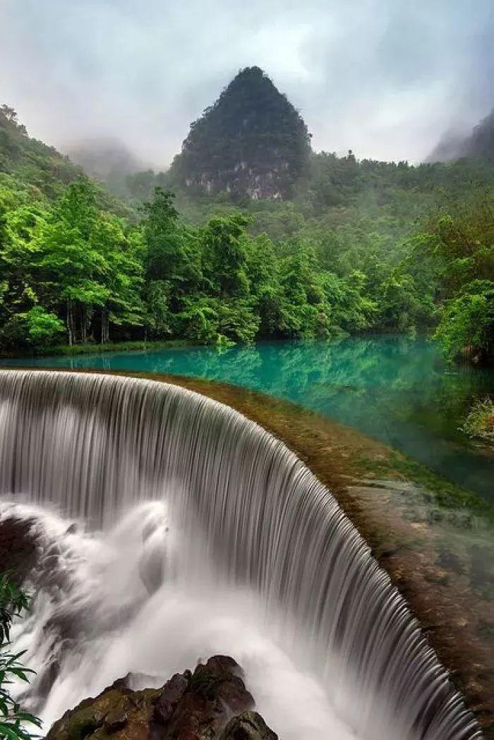 壁纸 风景 旅游 瀑布 山水 桌面 700_1049 竖版 竖屏 手机