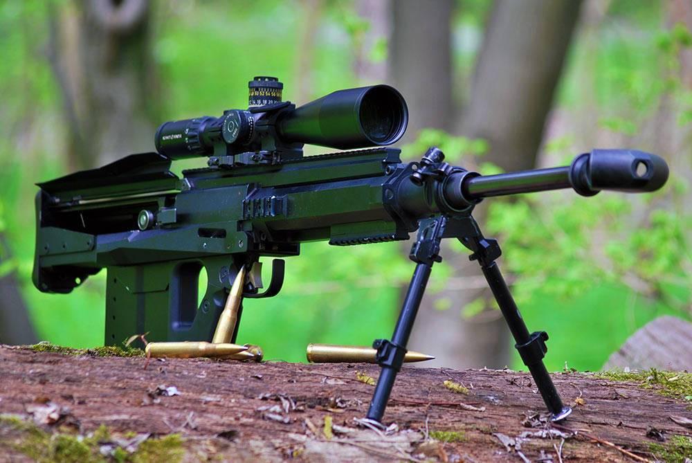 狙的原理_第九位:dsr-50狙击步枪   dsr-50是一把基于老款dsr-1设计的狙击步枪,它被改进以发射威力更强的50英寸口径弹药.