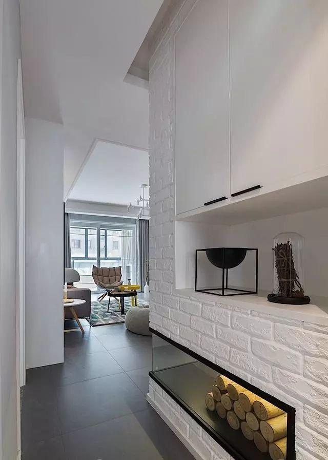 时尚 正文  面积:138平 风格:北欧风格 玄关 玄关里做了个独特的壁炉