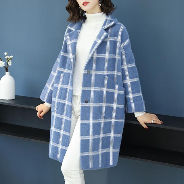 简约大方不失美观 英伦风衣外套,非常足够肥的尺码,口袋设计很有特色图片