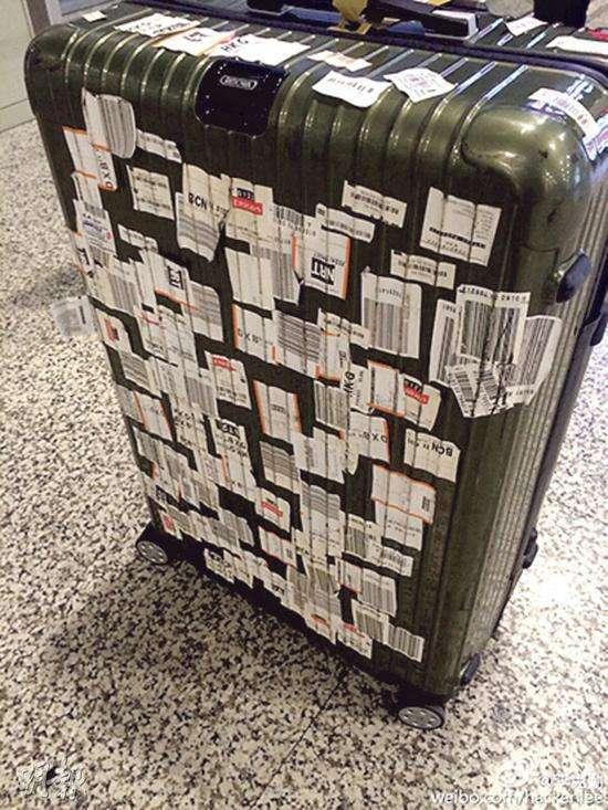 不撕掉旅行箱上的行李牌?原来有这番含义_托运
