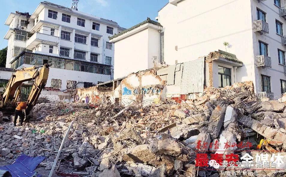 擂鼓石大街中段建设工程有了新动作 红门路东侧沿街楼拆除