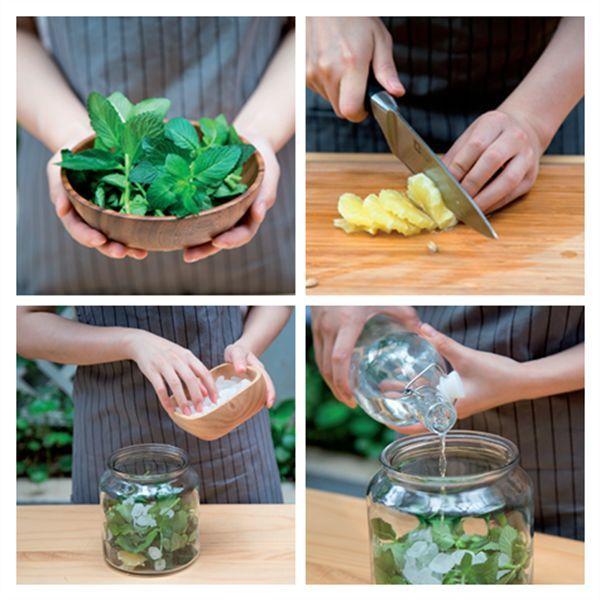 将薄荷,柠檬和冰糖放入可密封的玻璃瓶内, 向瓶中缓缓倒入白酒.图片