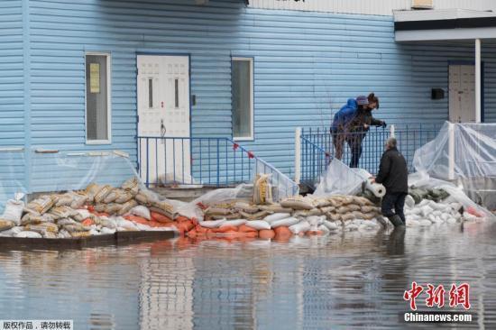 加拿大东部地区遭到洪灾侵袭 约1200人被迫疏散