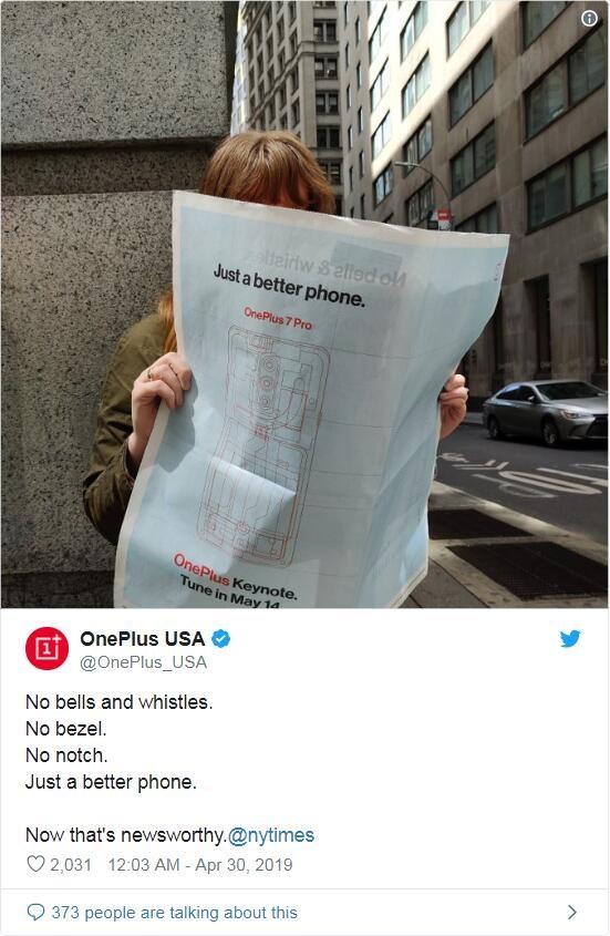 一加官方发布一加7 Pro报纸版广告:后置三摄+弹出前摄