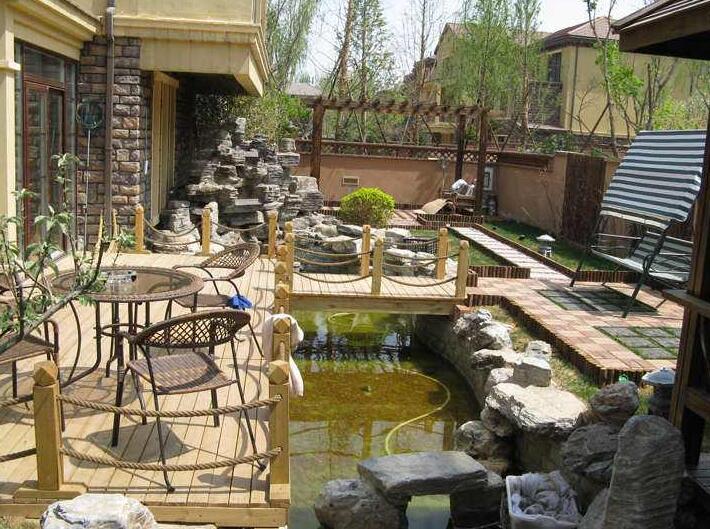 """庭院水景设计的核心,围绕""""水""""的主题,那肯定要有一个水池,再配以假山图片"""