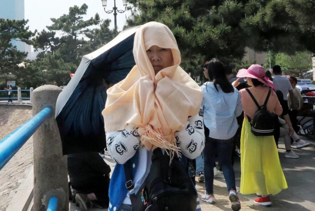 青岛发布今年首个高温橙色预警 39℃+8级风