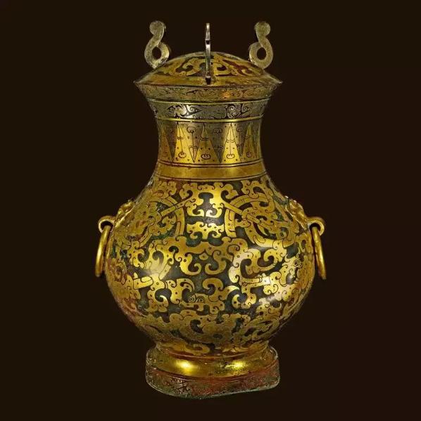 河北博物院藏鎏金银蟠龙纹铜壶可谓一件名器.