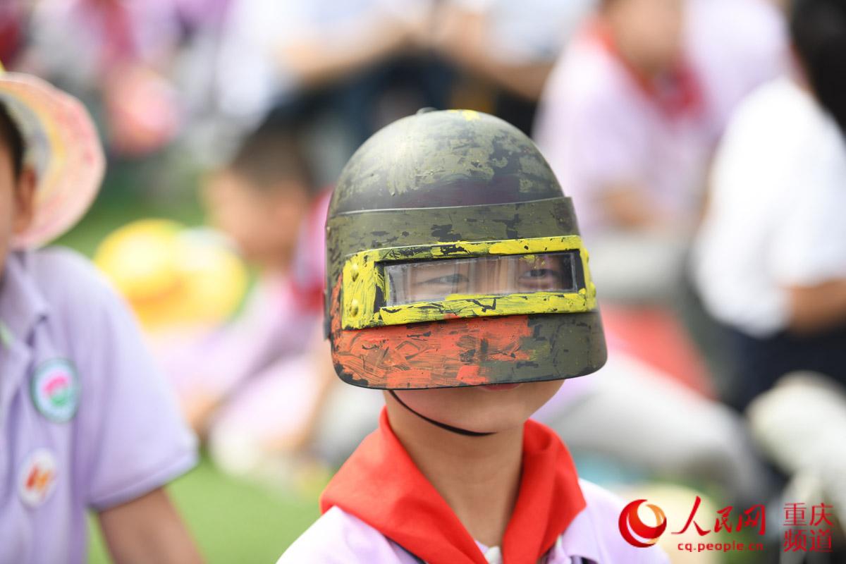 六一童趣 重庆小学生的创意帽子图片