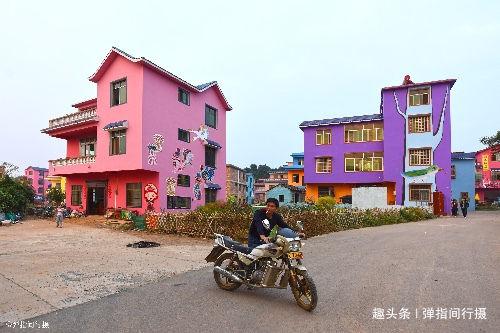 <b>广西贺州偏远乡村,促旅游有奇招,投700万将房屋画满七彩涂鸦</b>