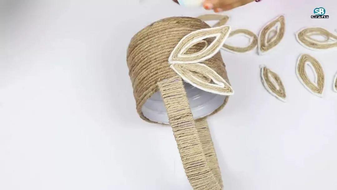 用废旧塑料瓶   毛线 diy 了一个玫瑰花篮,有创意 (附