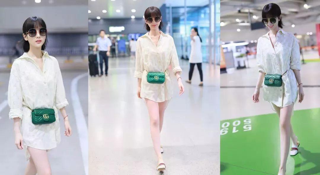 毛晓彤最新机场私服一手oversize衬衫配穆勒鞋造型嫩回20岁