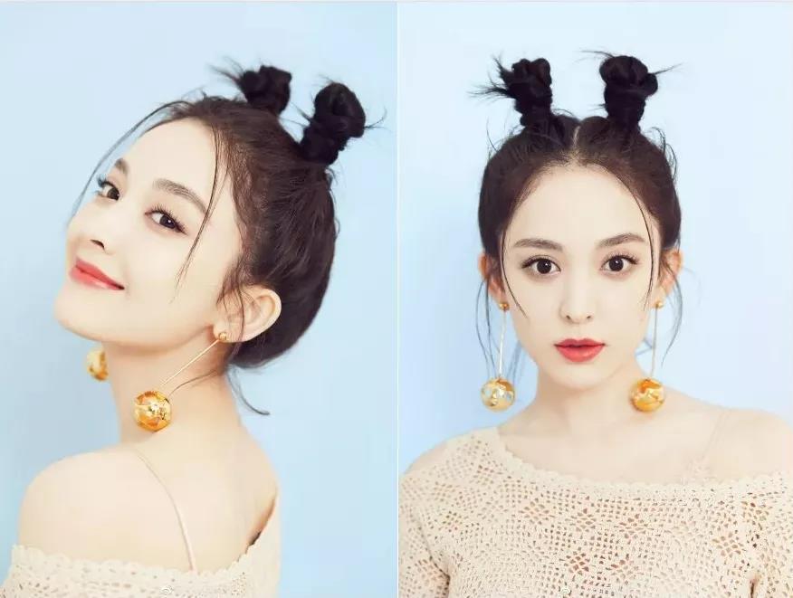 为电影唱了片尾曲的bgm女王张碧晨,特意扎着同款发型和小哪吒合影,像图片