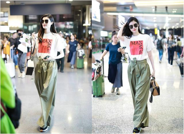 何穗机场当秀场,穿简单T恤配高腰阔腿裤,戴墨镜尽显超模气场插图(3)