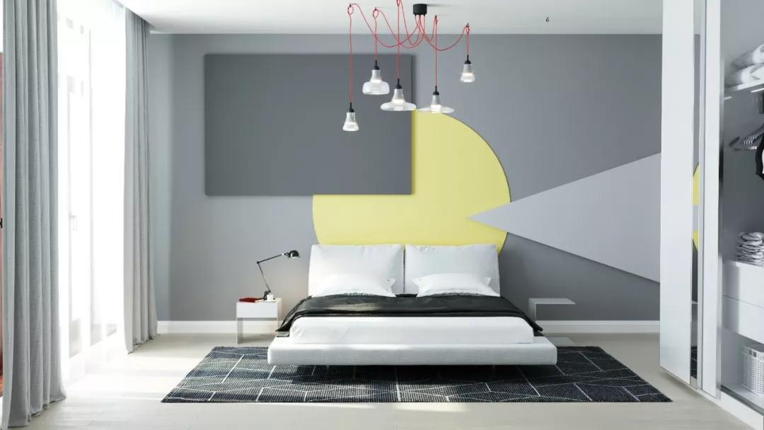 热烈明亮的黄色沙发占据客厅一角,在灰白色墙壁的衬托下显得热情动人