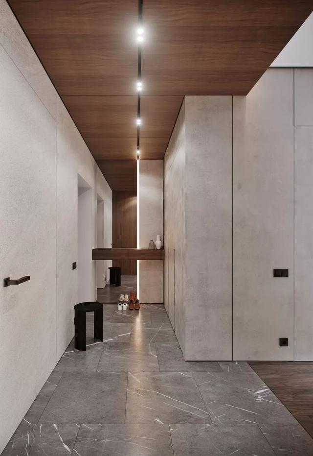 125㎡打造出大平层效果,木饰面拼接大理石,这个电视背景墙真酷