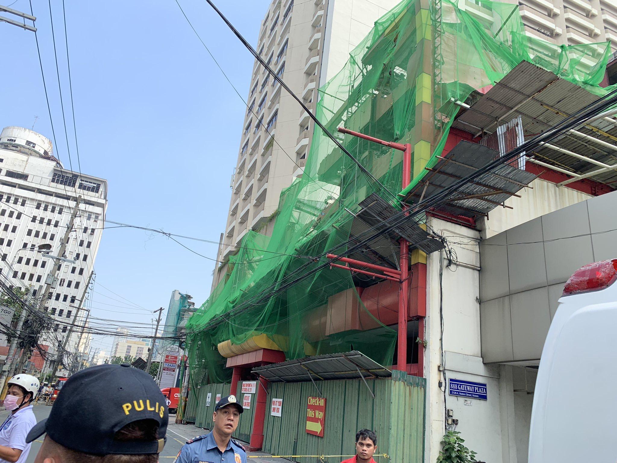 菲律宾一家汽车旅店坍塌 数人受伤2人掉踪