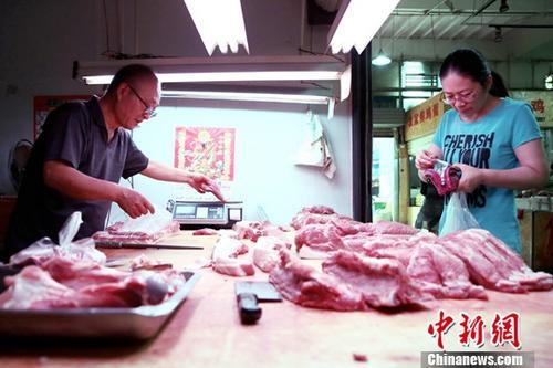 """中国将再投放一万吨储备猪肉保""""十一""""时代市场供给"""
