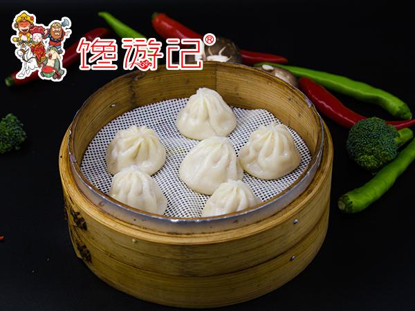 传统民族特色小吃--馋游记灌汤小笼包_民族小吃