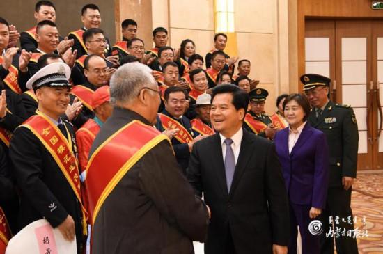 全区退役军人工作会议召开李纪恒布小林马庆雷会见受表彰单位代表和个人