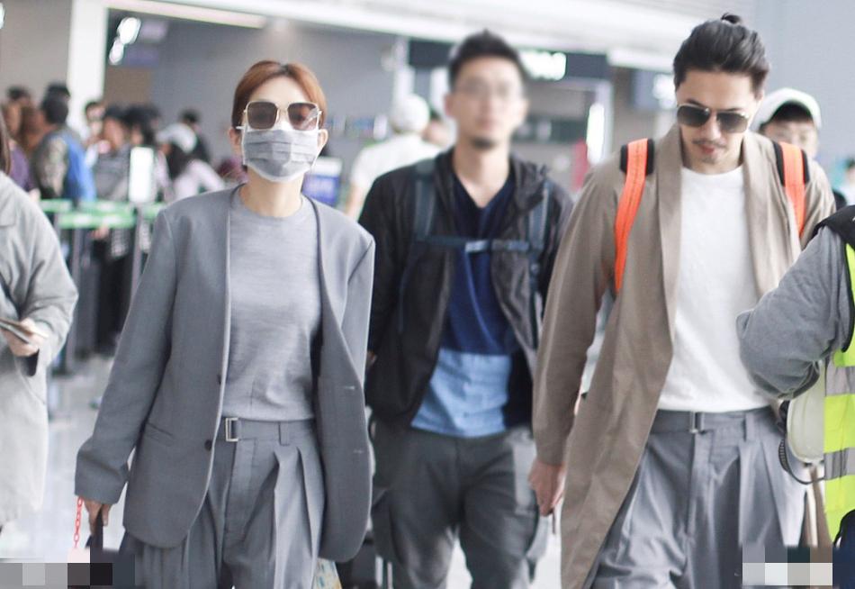 Ella与帅气老公走机场,穿同款纸袋裤甜蜜秀恩爱,28cm身高差瞩目