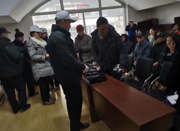 寒冬送关怀 真情暖人心——新华人寿保险送温暖活动