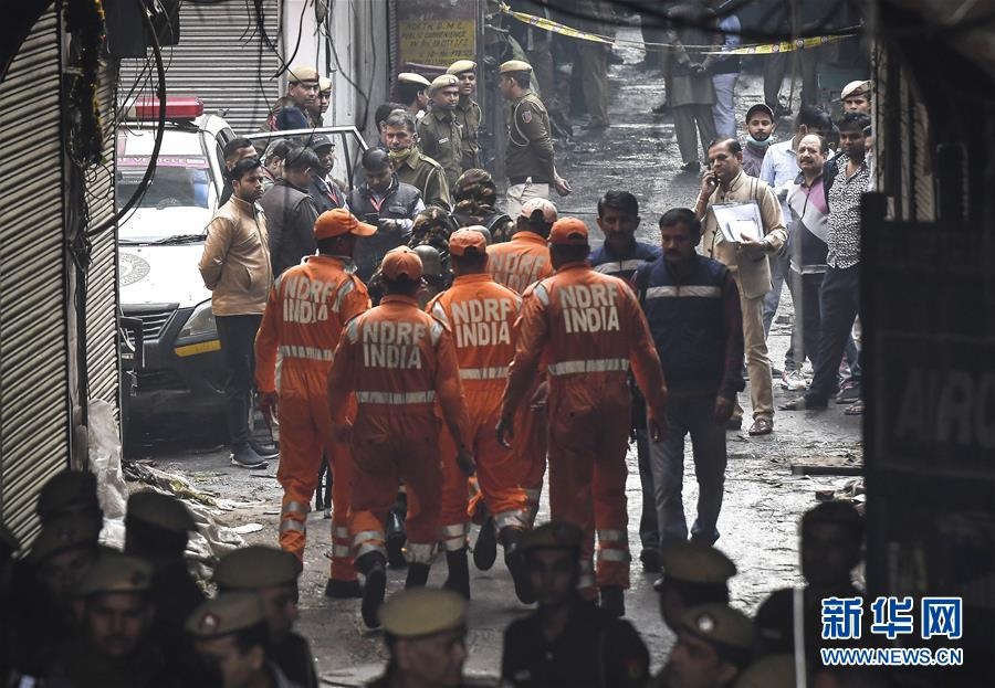 印度一商業樓發生火災致32人死亡_新華社