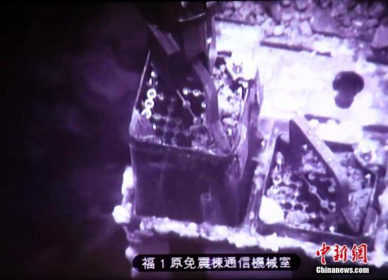 <b>福岛核事故损毁厂房:面目全非 需穿多层防护服进入</b>