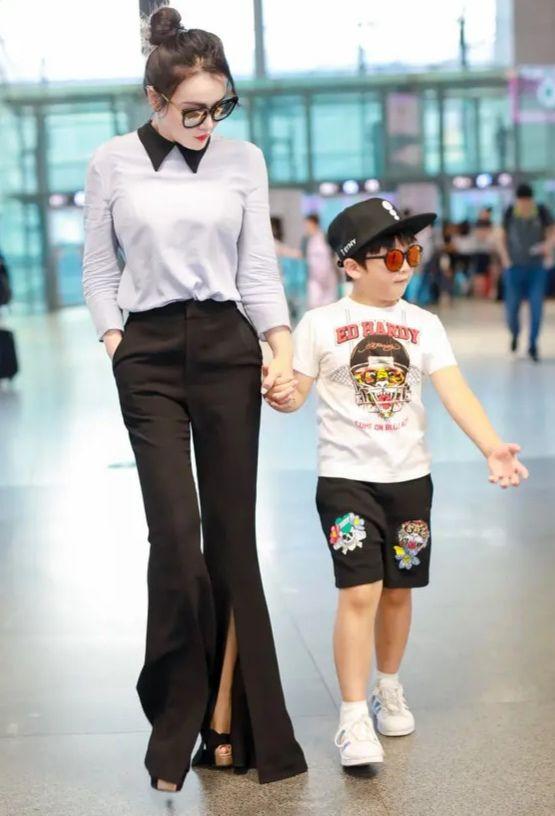 冉莹颖不秀身材没啥看点,穿连体裤亮相机场,低调的像普通女人!