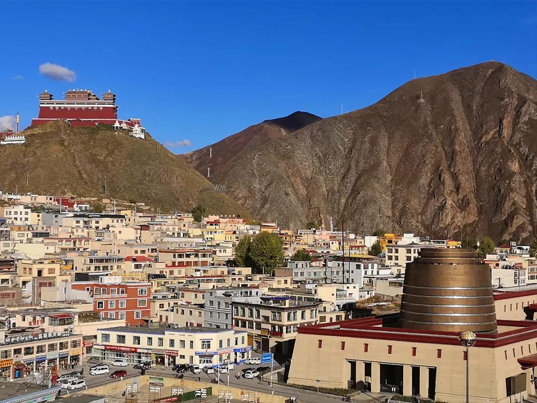 原创比G318低调,这条贯穿青藏滇的国道如何诠释中国西部之美?|中国自驾地理