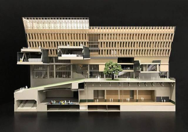 教学楼顶层的课室呈Y字形向外悬挑,配合天窗及反射墙,把阳光与自然图片