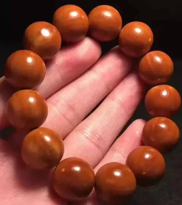 正圆橄榄核包浆囹�a_橄榄核正圆光珠,可以说是玩橄榄核雕的必备款,表面光滑好把玩,易包浆