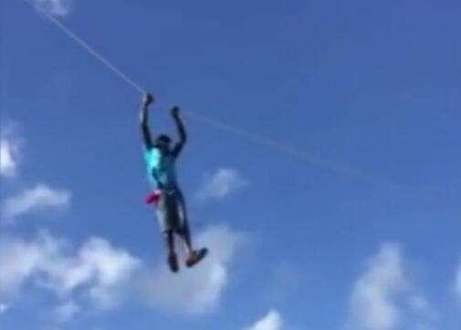 小伙放风筝被带上天 飞上天与太阳肩并肩