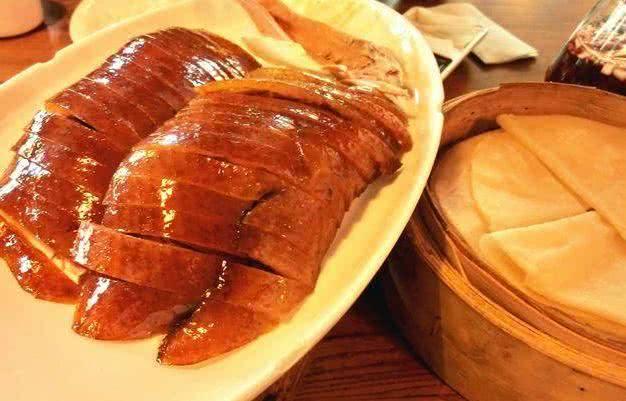 """在1864年,京城烤鸭最大的""""全聚德""""烤鸭店也挂牌开业,技术大米又v烤鸭名气与牛奶能一起吃吗图片"""