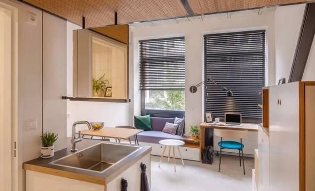 这是一套32平的小户型loft单身公寓,设计师通过简单的硬装和软装来