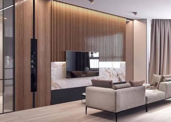 1,木质背景墙设计 以木饰面作为电视背景墙, 能为冰冷的空间注入一丝