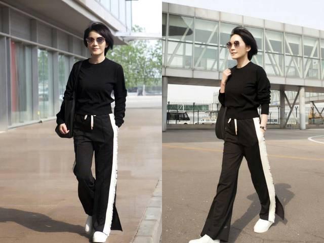 女神俞飞鸿,这一套黑色运动裤搭配黑色针织衫的搭配本来算是普通平淡